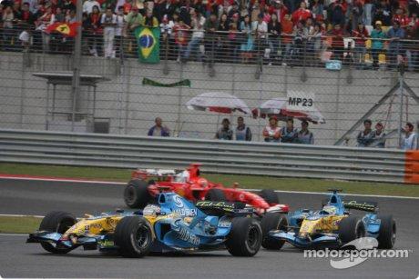 Fernando Alonso leads Giancarlo Fisichella and Michael Schumacher