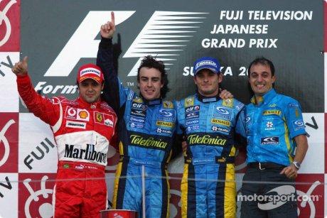 race winner Fernando Alonso with Felipe Massa, Giancarlo Fisichella and Frederic Lom