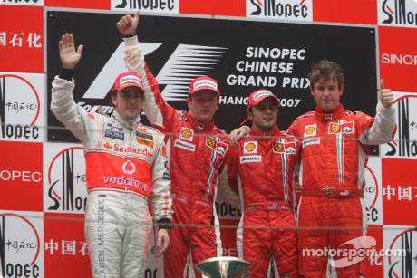 2nd place Fernando Alonso, McLaren Mercedes with 1st place Kimi Raikkonen, Scuderia Ferrari, 3rd place Felipe Massa, Scuderia Ferrari and Rob Smedly,, Scuderia Ferrari, Track Engineer of Felipe Massa