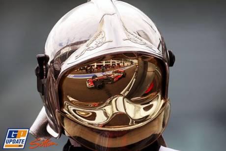 A McLaren seen in the visor of an offical