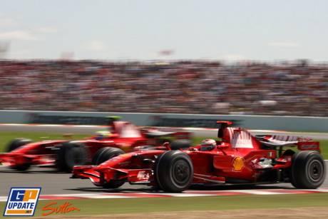 Felipe Masse (Scuderia Ferrari) is overtaking Kimi Raikkonen (Scuderia Ferrari)