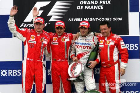 race winner Felipe Massa with Kimi Raikkonen, Jarno Trulli and Luca Baldisserri
