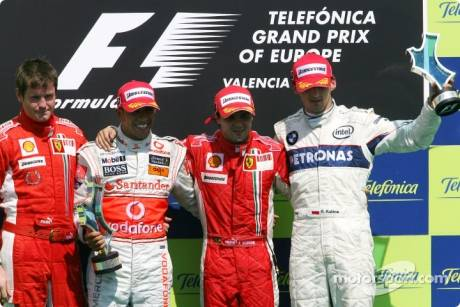 race winner Felipe Massa, second place Lewis Hamilton, third place Robert Kubica, and Rob Smedly