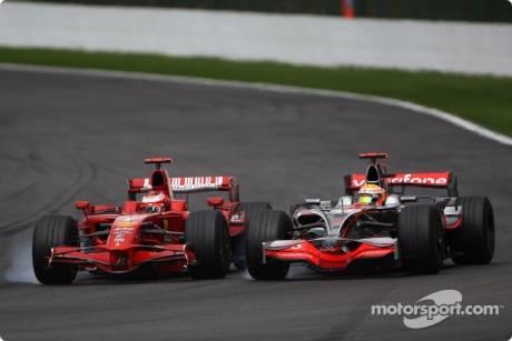 Kimi Raikkonen, Scuderia Ferrari (F2008) overtakes Lewis Hamilton, McLaren Mercedes (MP4-23)