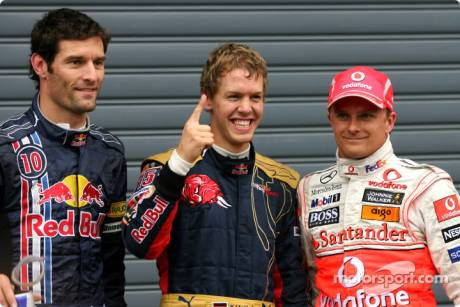 Pole winner Sebastian Vettel, second place Heikki Kovalainen, third place Mark Webber