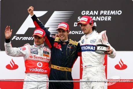 race winner Sebastian Vettel, second place Heikki Kovalainen, third place Robert Kubica