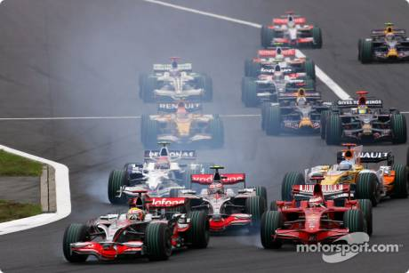 Start of the race, Lewis Hamilton, McLaren Mercedes (MP4-23) and Kimi Raikkonen, Scuderia Ferrari (F2008) battle for the lead