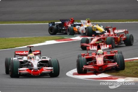 Felipe Massa, Scuderia Ferrari (F2008) and Lewis Hamilton, McLaren Mercedes (MP4-23)