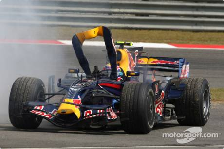 Mark Webber, Red Bull Racing (RB4) stops after a engine blow and fire