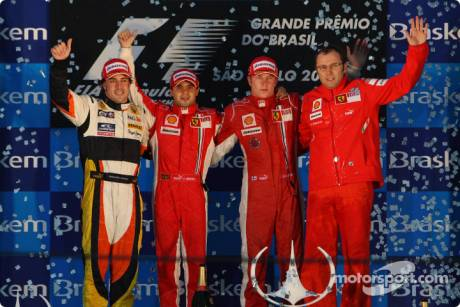 race winner Felipe Massa, second place Fernando Alonso, third place Kimi Raikkonen, and Scuderia Ferrari Sporting Director Stefano Domenicali