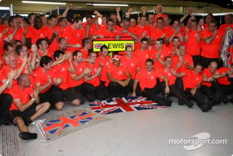 2008 World Champion Lewis Hamilton celebrates with McLaren Mercedes team members