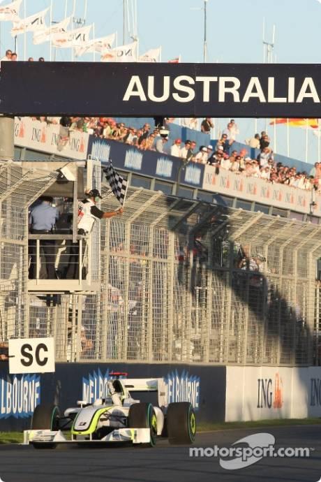 Jenson Button, Brawn GP F1 Team (BRAWNGP001) takes the checkered flag