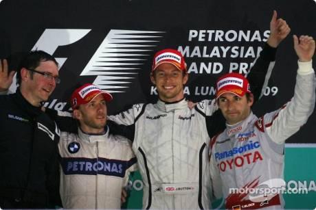 Podium: race winner Jenson Button, Brawn GP F1 Team, second place Nick Heidfeld, BMW Sauber F1 Team, third place Timo Glock, Toyota F1 Team