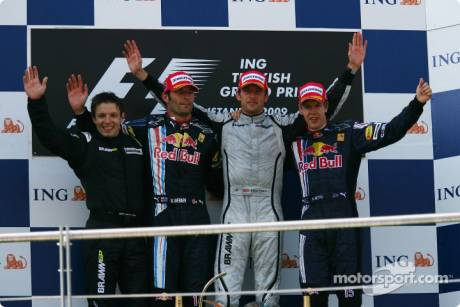 Podium: race winner Jenson Button, Brawn GP with second place Mark Webber, Red Bull Racing and third place Sebastian Vettel, Red Bull Racing