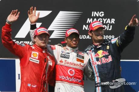 Podium: race winner Lewis Hamilton (McLaren Mercedes), second place Kimi Raikkonen (Scuderia Ferrari) and third place Mark Webber (Red Bull Racing)