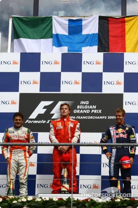 2nd Giancarlo Fisichella (Force India F1 Team), 1st Kimi Raikkonen (Scuderia Ferrari) and 3rd Sebastian Vettel (Red Bull Racing)