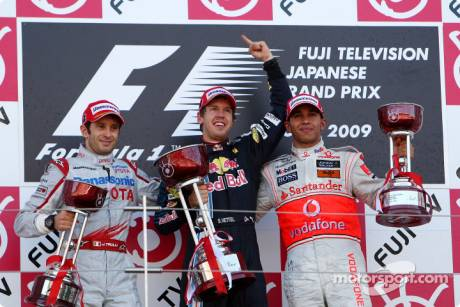 Podium: Race Winner Sebastian Vettel (Red Bull Racing), Second Place Jarno Trulli (Toyota F1 Team) and Third Place Lewis Hamilton (McLaren Mercedes)
