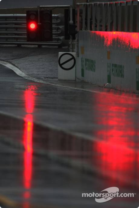 The session is flagged red and starts late due to rain