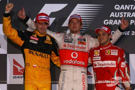 Podium: Race Winner Jenson Button (McLaren Mercedes), Second Place Robert Kubica (Renault F1 Team) and Third Place Felipe Massa (Scuderia Ferrari)