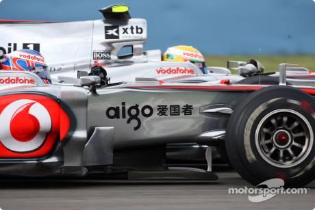 Jenson Button and Lewis Hamilton (McLaren Mercedes, MP4-24)