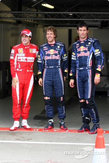 Pole Winner Sebastian Vettel (Red Bull Racing), with Second Place Mark Webber (Red Bull Racing) and Third Place Fernando Alonso (Scuderia Ferrari)