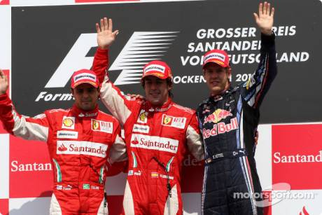 Podium: Race Winner Fernando Alonso (Scuderia Ferrari), Second Place Felipe Massa (Scuderia Ferrari) and Third Place Sebastian Vettel (Red Bull Racing)