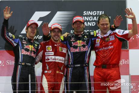 Podium: Race Winner Fernando Alonso (Scuderia Ferrari), Second Place Sebastian Vettel (Red Bull Racing) and Third Place Mark Webber (Red Bull Racing)