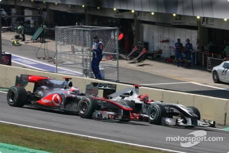 Michael Schumacher (Mercedes GP F1 Team, MGP W01) passes Jenson Button (McLaren Mercedes, MP4-25)