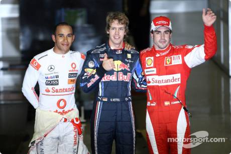 Pole Winner Sebastian Vettel (Red Bull Racing), Second Place Lewis Hamilton (McLaren Mercedes) and Third Place Fernando Alonso (Scuderia Ferrari)