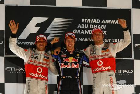 Podium: Race Winner and 2010 Formula One World Champion Sebastian Vettel (Red Bull Racing), Second Place Lewis Hamilton (McLaren Mercedes) and Third Place Jenson Button (McLaren Mercedes)
