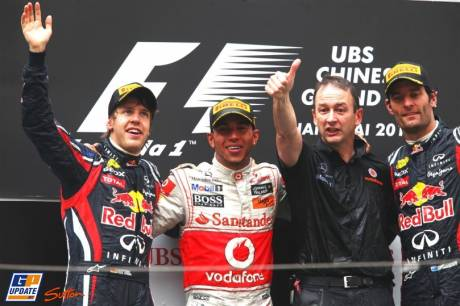 The Podium : Second Place Sebastian Vettel (Red Bull Racing), First Place Lewis Hamilton (McLaren Mercedes) and Third Place Mark Webber (Red Bull Racing)