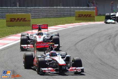 Jenson Button (McLaren Mercedes, MP4-26) and Lewis Hamilton (McLaren Mercedes, MP4-26)