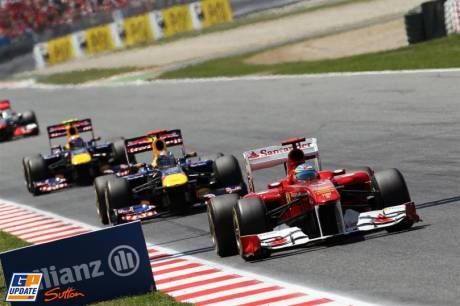 Fernando Alonso (Scuderia Ferrari, 150 Italia), Sebastian Vettel and Mark Webber (Red Bull Racing, RB7)