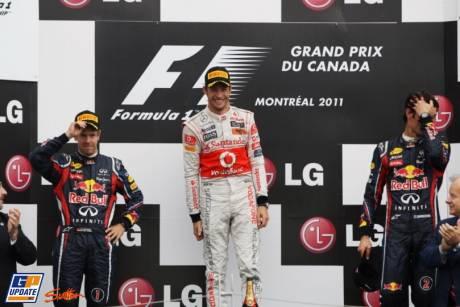 The Podium : Second Place Sebstian Vettel (Redd Bull Racing), Race Winner Jenson Button (McLaren Mercedes) and Third Place Mark Webber (Red Bull Racing)