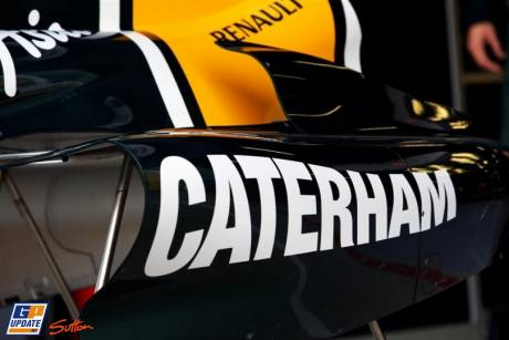 The Caterham logo on the Team Lotus T128
