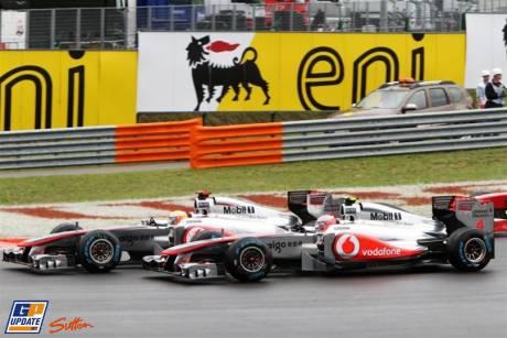 Lewis Hamilton (McLaren Mercedes, MP4-26) and Jenson Button (McLaren Mercedes, MP4-26) Battling For Position