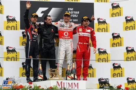 The Podium : Second Place Sebastian Vettel (Red Bull Racing), Race Winner Jenson Button (McLaren Mercedes) and Third Place Fernando Alonso (Scuderia Ferrari)