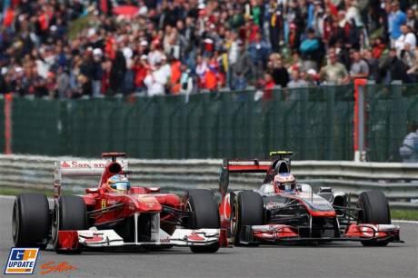 Fernando Alonso (Scuderia Ferrari, Italia 150) and Jenson Button (McLaren Mercedes, MP4-26)
