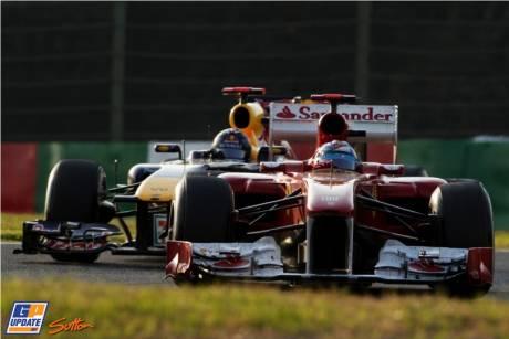 Fernando Alonso (Scuderia Ferrari, Italia 150) and Sebastian Vettel (Red Bull Racing, RB7)