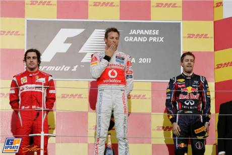 The Podium : Second Place Fernando Alonso (Scuderia Ferrari), Race Winner Jenson Button (McLaren Mercedes) and Third Place Sebastian Vettel (Red Bull Racing)