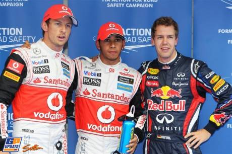 The Top Three Qualifiers : Third Place Jenson Button (McLaren Mercedes), Pole Position Lewis Hamilton (McLaren Mercedes) and Second Place Sebastian Vettel (Red Bull Racing)
