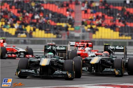Heikki Kovalainen (Team Lotus, T128) leads Jarno Trulli (Team Lotus, T128)