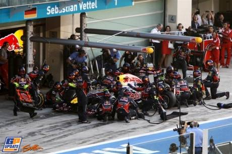 The pit stop for Sebastian Vettel (Red Bull Racing, RB7) after his spin with a punctured rear tyre