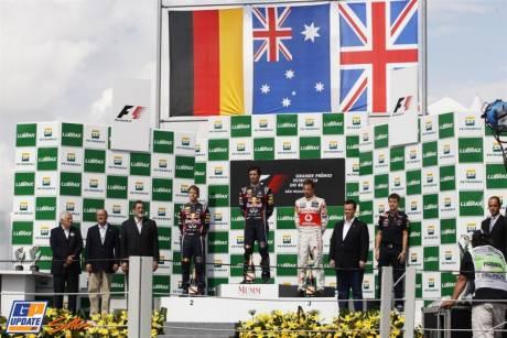 The Podium : Second Place Sebastian Vettel (Red Bull Racing), Race Winner Mark Webber (Red Bull Racing) and Third Place Jenson Button (McLaren Mercedes)