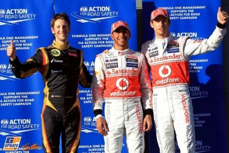 The Top Three Qualifiers : Third Place Romain Grosjean (Lotus Renaul GP), Pole Position Lewis Hamilton (McLaren Mercedes) and Second Place Jenson Button (McLaren Mercedes)