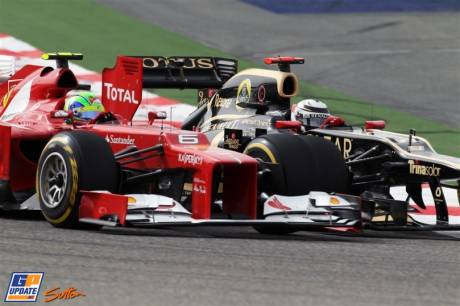 Kimi Raikkonen (Lotus Renault GP, E20) and Felipe Massa (Scuderia Ferrari, F2012)