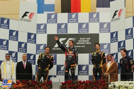 The Podium : Second Place Kimi Raikkonen (Lotus Renault GP), Race Winner Sebastian Vettel (Red Bull Racing), Third Place Romain Grosjean (Lotus Renault GP) and Christian Horner (Red Bull Racing)