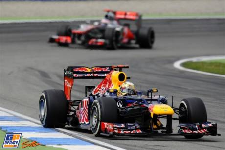 Sebastian Vettel (Red Bull Racing, RB8) leading Jenson Button (McLaren Mercedes, MP4-27)