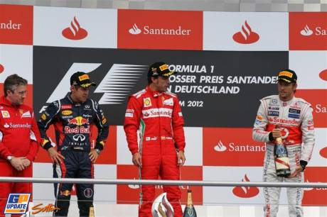 The Podium : Second Place Sebastian Vettel (Red Bull Racing), Race Winner Fernando Alonso (Scuderia Ferrari) and Third Place Jenson Button (McLaren Mercedes)