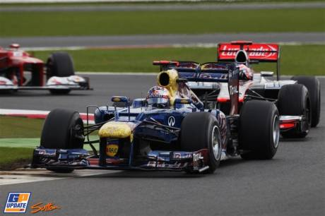 Sebastian Vettel (Red Bull Racing, RB8) and Jenson Button (McLaren Mercedes, MP4-27)
